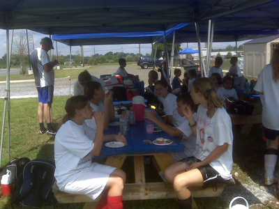 Eating at a summer soccer camp